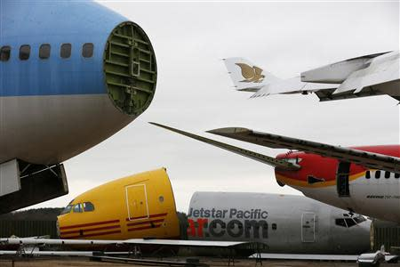 Dismantled planes are seen in the recycling yard of Air Salvage International (ASI) in Kemble, central England November 27, 2013. REUTERS/Stefan Wermuth