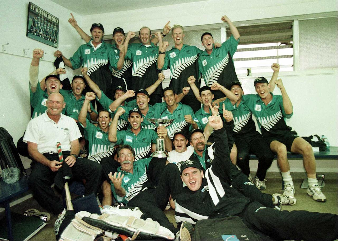 15 Oct 2000:  Stephen Fleming the captain of New Zealand holds the trophy as the rest of the team celebrate after beating  India in the final of the ICC Knockout Tournament at the Gymkhana Ground, Nairobi, Kenya Mandatory Credit: Tom Shaw/ALLSPORT