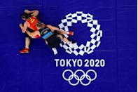 <p>Aline Rotter Focken of Team Germany competes against Qian Zhou of Team China during the Women's Freestyle 76kg Quarter Final on day nine of the Tokyo 2020 Olympic Games at Makuhari Messe Hall on August 01, 2021 in Chiba, Japan. (Photo by Rob Carr/Getty Images)</p>