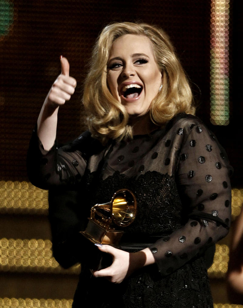 """FILE - In this Feb. 12, 2012 file photo, Adele accepts the award for record of the year for """"Rolling in the Deep"""" during the 54th annual Grammy Awards, in Los Angeles. Adele rolled so deep in 2012 that she's been voted The Associated Press Entertainer of the Year. (AP Photo/Matt Sayles, File)"""