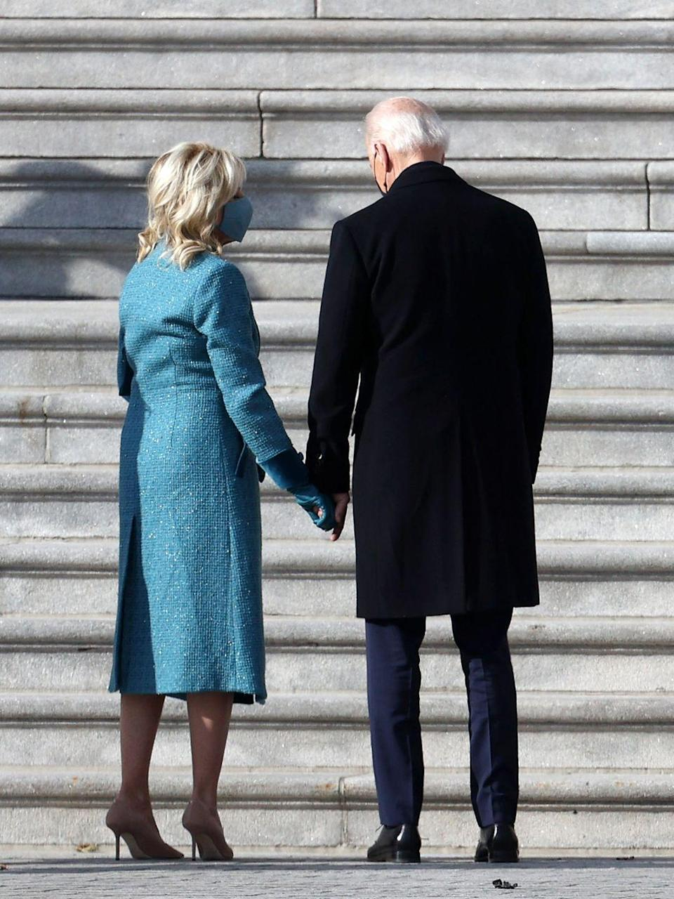 <p>President-elect Joe Biden and Dr. Jill Biden sharing a moment together on the East Front of the U.S. Capitol</p>