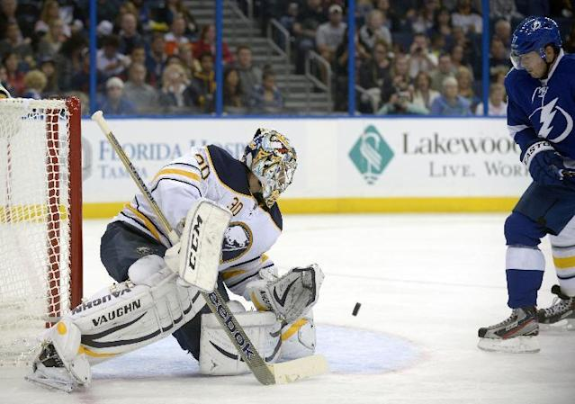 Buffalo Sabres goalie Ryan Miller (30) blocks a shot in front of Tampa Bay Lightning center Alex Killorn (17) during the second period of an NHL hockey game in Tampa, Fla., Saturday, Oct. 26, 2013. (AP Photo/Phelan M. Ebenhack)
