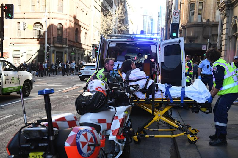 A women is taken by ambulance from Hotel CBD at the corner of King and York Street in Sydney, Tuesday, August 13, 2019. Source: AAP Image/Dean Lewins