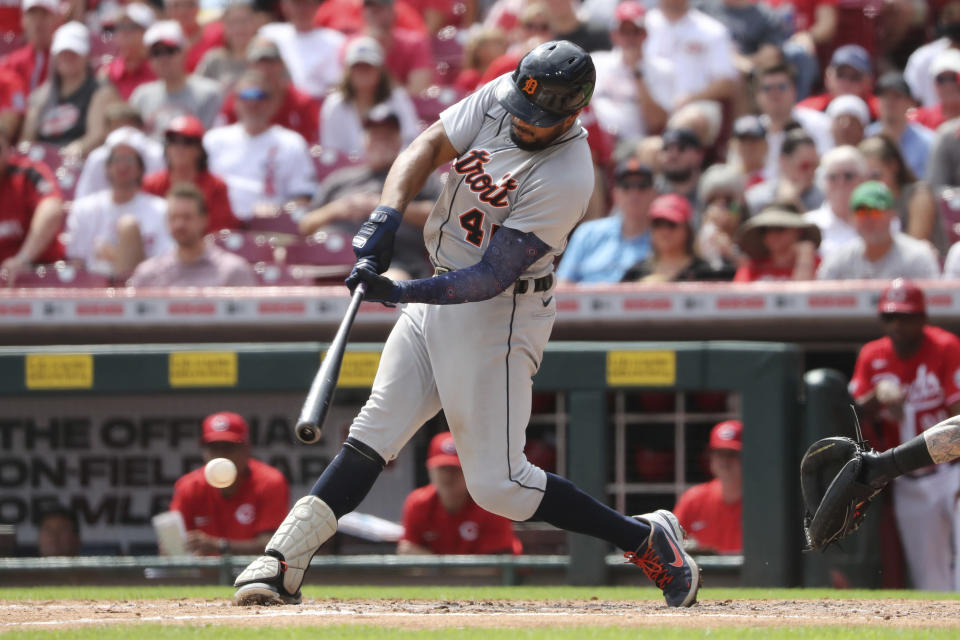 Detroit Tigers' Jeimer Candelario hits a two-run single off Cincinnati Reds starting pitcher Luis Castillo during the sixth inning of a baseball game, Sunday, Sept. 5, 2021, in Cincinnati. (AP Photo/Gary Landers)