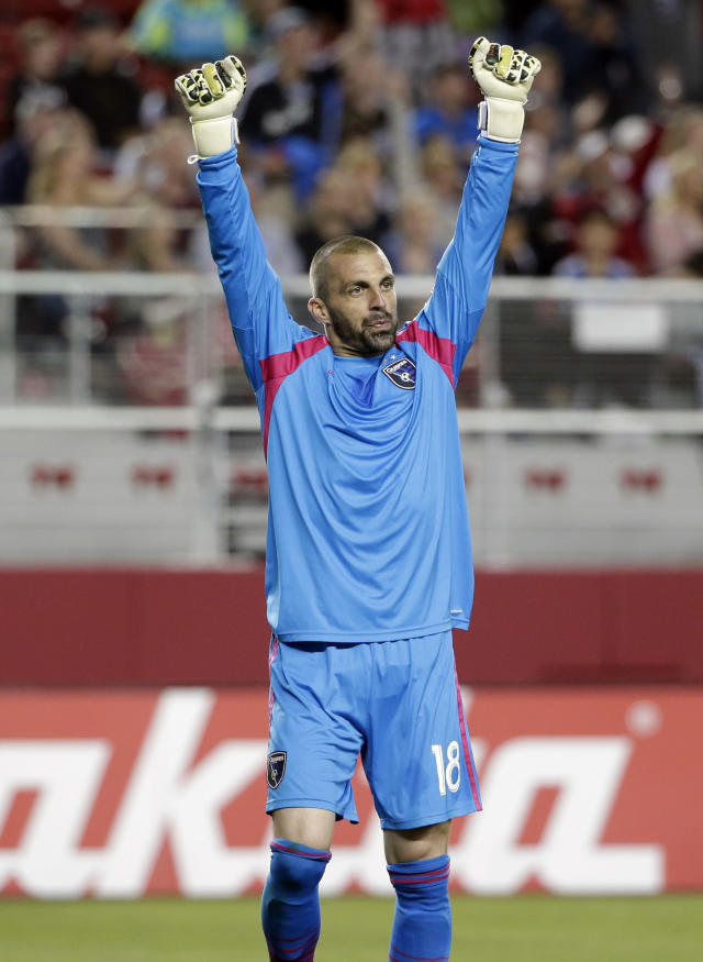 San Jose Earthquakes goalkeeper Jon Busch celebrates after a 1-0 win over the Seattle Sounders during the second half of an MLS soccer match on Saturday, Aug. 2, 2014, in Santa Clara, Calif. (AP Photo/Marcio Jose Sanchez)