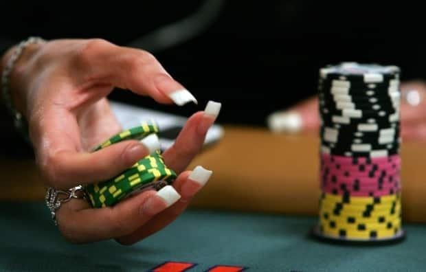 A poker player plays with her chips at the Rio Hotel & Casino in Las Vegas. (Ethan Miller/Getty Images - image credit)