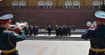Russian President Vladimir Putin, center, delivers his speech standing next to a small group of Russian WWII veterans during a wreath laying ceremony at the Tomb of Unknown Soldier in Moscow, Russia, Tuesday, June 22, 2021, marking the 80th anniversary of the Nazi invasion of the Soviet Union. (Alexei Nikolsky, Sputnik, Kremlin Pool Photo via AP)