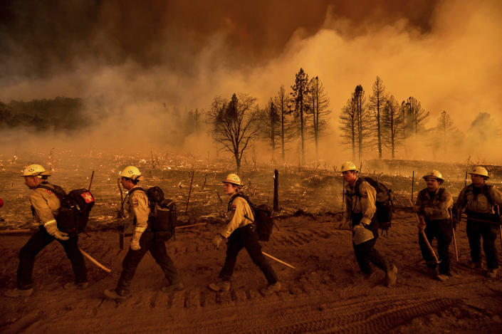 Firefighters from the California Department of Forestry and Fire Protection's Placerville station battle the Sugar Fire, part of the Beckwourth Complex Fire, in Doyle, Calif., on Friday, July 9, 2021. (AP Photo/Noah Berger)