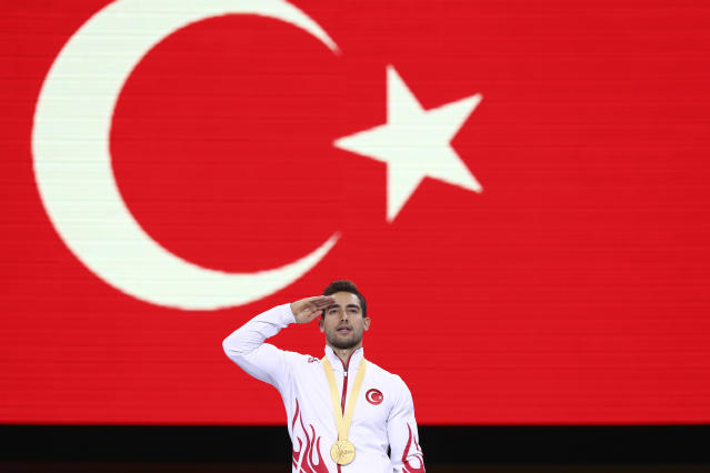 Gold medalist on the rings Ibrahim Colak of Turkey celebrates on the podium after the men's apparatus finals at the Gymnastics World Championships in Stuttgart, Germany, Saturday, Oct. 12, 2019. (AP Photo/Matthias Schrader)