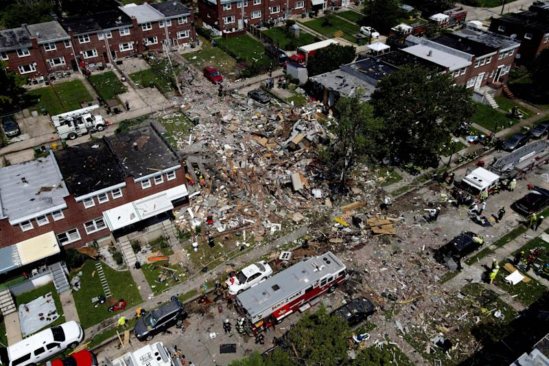 Debris and rubble cover the ground in the aftermath of an explosion in Baltimore on Monday, Aug. 10, 2020. Baltimore firefighters say an explosion has leveled several homes in the city.