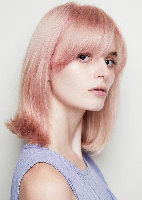 """<a href=""""https://www.glamour.com/story/best-pink-hair-dye-diy-advice?mbid=synd_yahoo_rss"""" rel=""""nofollow noopener"""" target=""""_blank"""" data-ylk=""""slk:DIY pink"""" class=""""link rapid-noclick-resp"""">DIY pink</a> had a major moment in quarantine. This summer, Tardo recommends trying a more unique take on the shade. """"I love a nuanced take on more playful hair colors,"""" he says. """"This blush tone feels like pink with an antique finish. The dusk pink look is great for the person who wants to try a fun hair trend that isn't screaming."""" He says that if you're already blond, you can try the shade with a low-commitment toner that will wash out in a few weeks. """"Bring photos to the salon to show the nuances that you like,"""" he says. """"Some hues are more rose, others are more coral. Ask for a soft, muted finish to the pink so that it doesn't look bubblegum."""""""