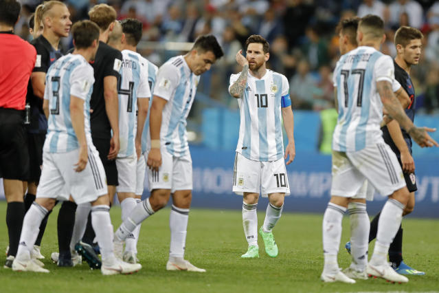 Argentina's Lionel Messi, centre, walks at the pitch during the group D match between Argentina and Croatia at the 2018 soccer World Cup in Nizhny Novgorod Stadium in Nizhny Novgorod, Russia, Thursday, June 21, 2018. Croatia defeated Argentina 3-0. (AP Photo/Ricardo Mazalan)