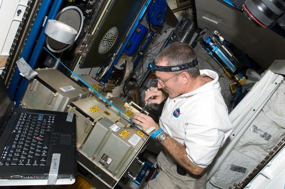 NASA astronaut Dan Burbank, Expedition 30 commander, works with the Major Constituent Analyzer Mass Spectrometer Assembly (MCA MSA) of the Atmosphere Revitalization system in the Tranquility node of the International Space Station. In the futur