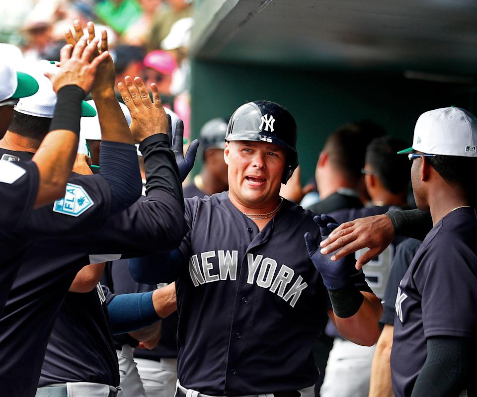 New York Yankees first baseman Luke Voit (45) celebrates in the dugout after hitting a two-run home run in the first inning of a spring training baseball game against the Baltimore Orioles, Sunday, March 17, 2019, in Sarasota, Fla. (AP Photo/John Bazemore