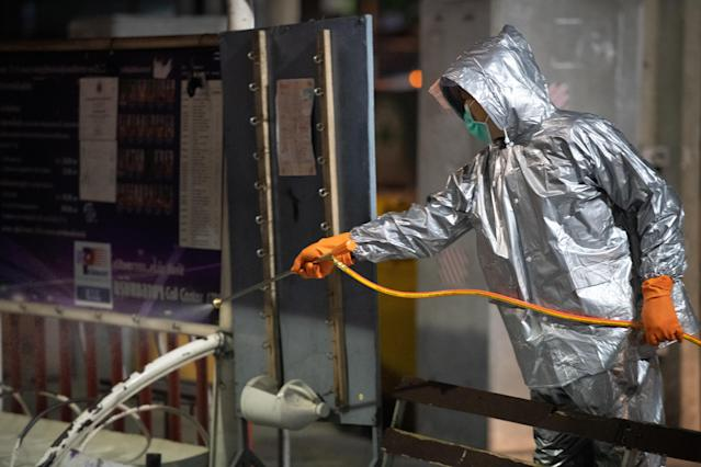 An army officer in a protective suit is pictured spraying disinfectant at a bus stop in Bangkok. Thailand has had 212 confirmed cases. (Getty Images)