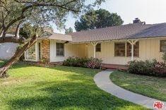 BEFORE: The traditional California ranch home before its modern updates.