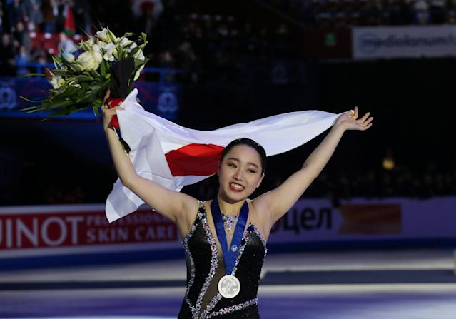 Figure Skating - World Figure Skating Championships - The Mediolanum Forum, Milan, Italy - March 23, 2018 Japan's Wakaba Higuchi celebrates with her medal after winning silver in the Ladies Free Skating REUTERS/Alessandro Bianchi