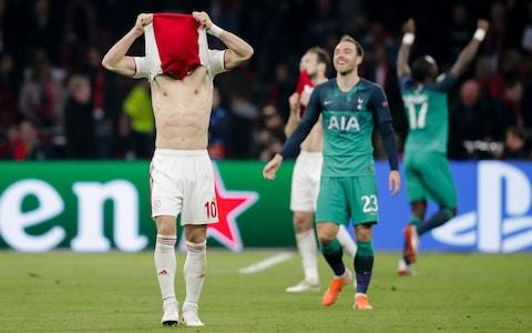 Dusan Tadic covers his face after Ajax's agonising defeat to Tottenham - Credit: getty images