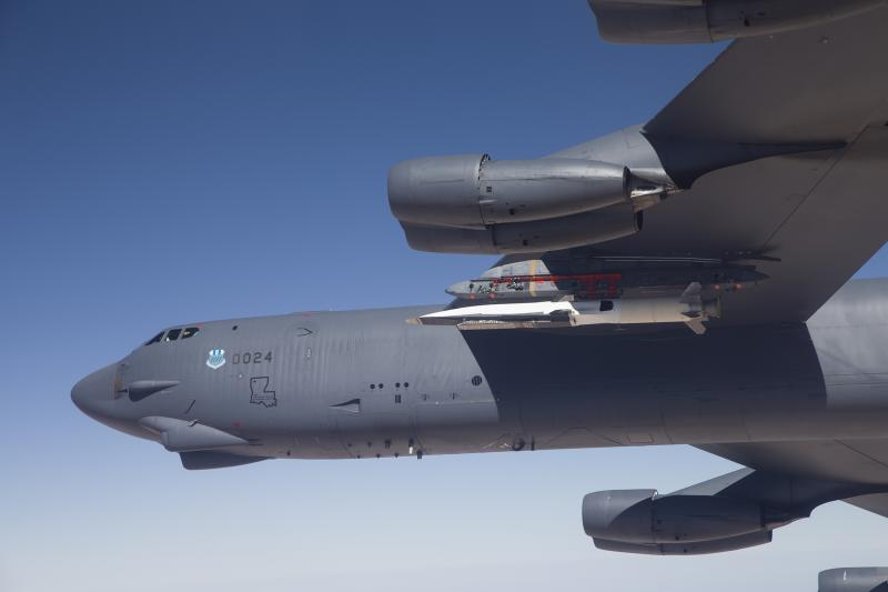 In this Wednesday, May 1, 2013 photo released by the U.S. Air Force, the X-51A Waverider, carried under the wing of a B-52H Stratofortress bomber,  prepares to launch for its fourth and final flight over the Pacific Ocean. The X-51A, an experimental, unmanned aircraft developed for the U.S. Air Force, went hypersonic during a test off the Southern California coast, traveling at more than 3,000 mph, the Air Force said Friday. The Air Force has spent $300 million studying scramjet technology that it hopes can be used to deliver strikes around the globe within minutes. (AP Photo/U.S. Air Force, Bobbi Zapka)