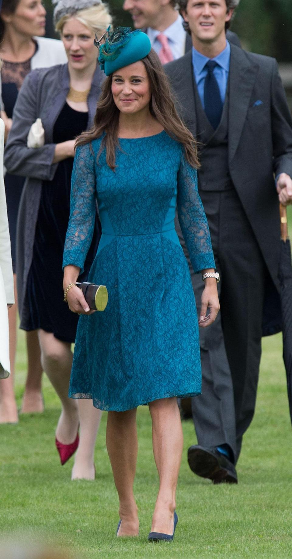 <p>Wearing a teal, lace Tabitha Webb dress to a wedding in 2013, Pippa took a leaf out of her sister's book and added a hat as the finishing touch.<i> [Photo: PA Images]</i> </p>
