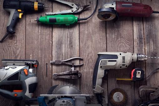 Collection of handheld power tools on work top