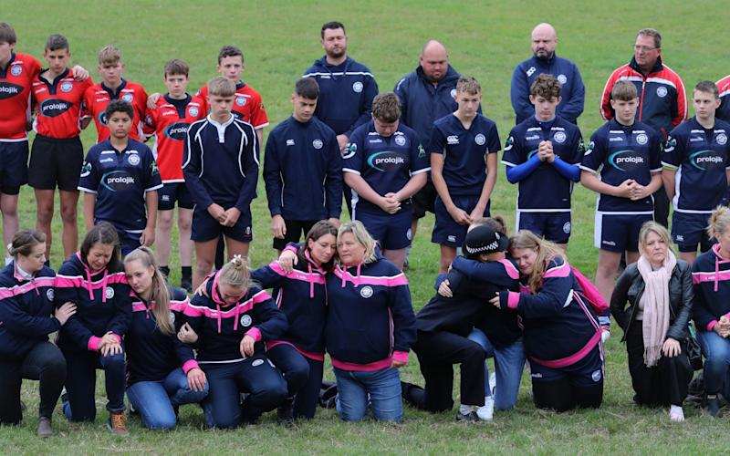 Players observe a minute's silence at East Grinstead Rugby Club - Gareth Fuller/PA Wire