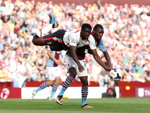 Liverpool's Kolo Toure (left) and Aston Villa's Christian Benteke (right) battle for the ball