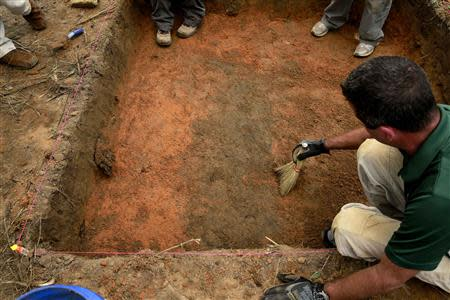 A team of anthropologists from the University of South Florida are exhuming suspected graves at the Boot Hill cemetery at the now closed Arthur G. Dozier School for Boys in Marianna, Florida, August 31, 2013. REUTERS/Edmund D Fountain/Pool