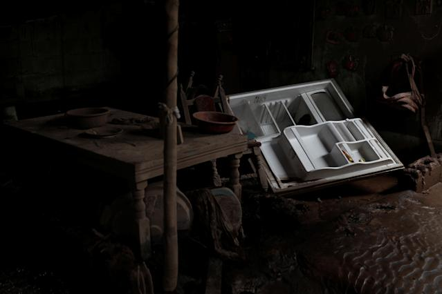<p>A refrigerator lies inside a kitchen of a house affected by the eruption of the Fuego volcano at San Miguel Los Lotes in Escuintla, Guatemala, June 8, 2018. (Photo: Carlos Jasso/Reuters) </p>