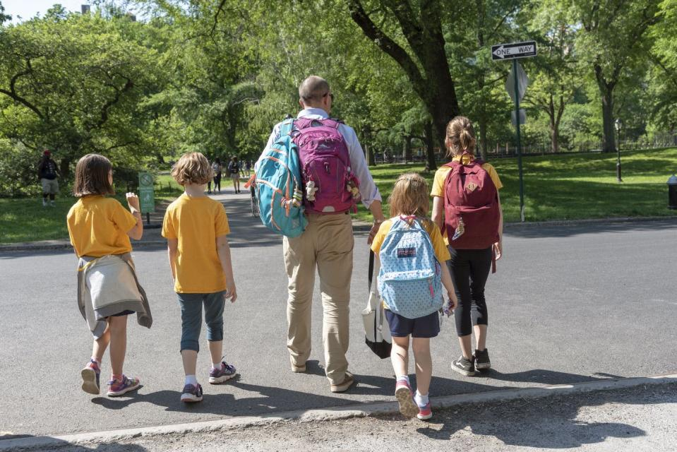 """<span class=""""caption"""">Raising children strains most household budgets.</span> <span class=""""attribution""""><a class=""""link rapid-noclick-resp"""" href=""""https://www.gettyimages.com/detail/news-photo/man-escorting-young-female-students-from-school-to-home-in-news-photo/1084632220"""" rel=""""nofollow noopener"""" target=""""_blank"""" data-ylk=""""slk:Universal Images Group Editorial/Getty Images"""">Universal Images Group Editorial/Getty Images</a></span>"""