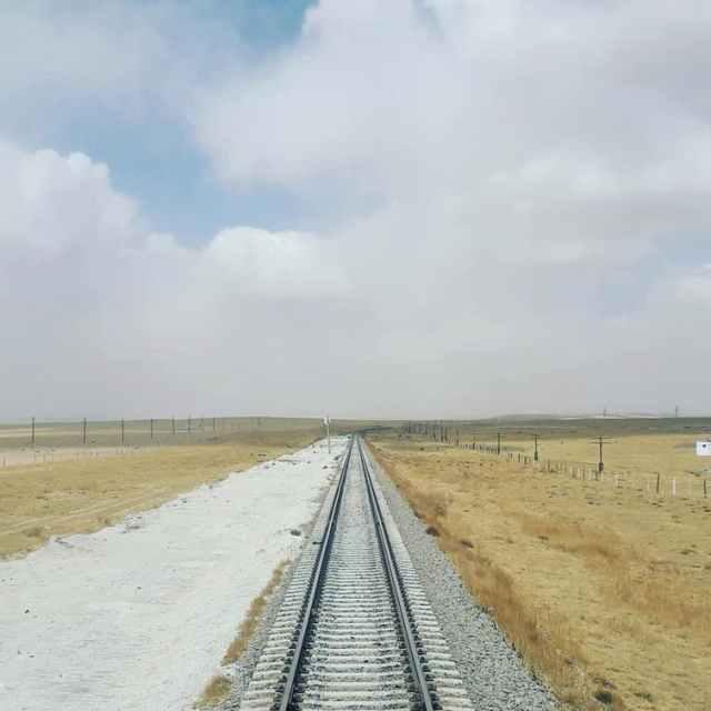A train track stretching for miles across the Mongolian plains