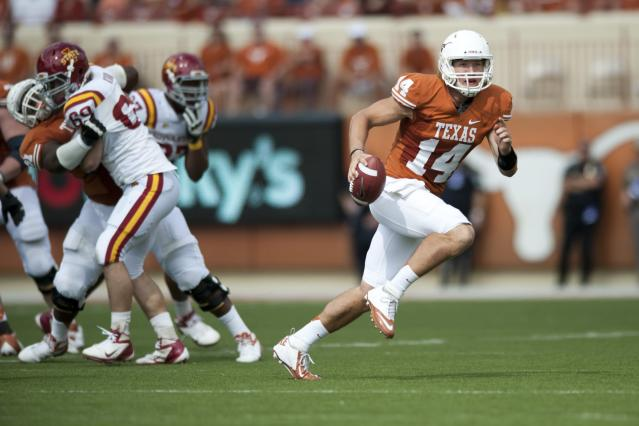AUSTIN, TX - NOVEMBER 10: David Ash #14 of the Texas Longhorns scrambles during the Big 12 Conference game against the Iowa State Cyclones on November 10, 2012 at Darrell K Royal-Texas Memorial Stadium in Austin, Texas. (Photo by Cooper Neill/Getty Images)