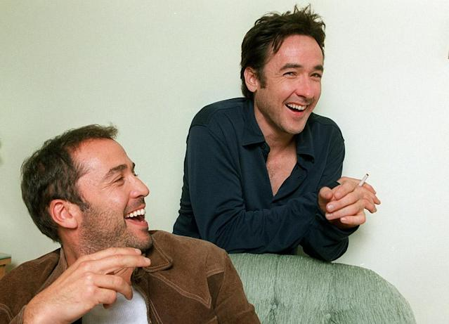"""<p>The actors met while growing up in Chicago and shared the screen in many movies in which Cusack starred. (Remember Piven's small role in """"Say Anything…""""?) They reportedly roomed together at one time — making them an earlier version of Matt and Ben –- but later had <a href=""""https://www.theguardian.com/culture/2015/jan/10/-sp-jeremy-piven-you-can-get-caught-up-in-getting-the-world-to-love-you"""" rel=""""nofollow noopener"""" target=""""_blank"""" data-ylk=""""slk:a public falling-out"""" class=""""link rapid-noclick-resp"""">a public falling-out</a>. (Photo: Gary Friedman/Los Angeles Times via Getty Images) </p>"""