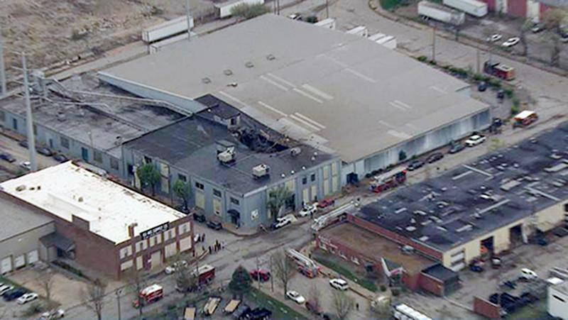 This Monday, April 3, 2017 photo from video provided by KMOV shows damage to the roof of a box company in St. Louis after a boiler exploded and flew before crashing through the roof of a nearby laundry business. Authorities said several people were killed as a result of the explosion. (KMOV via AP)