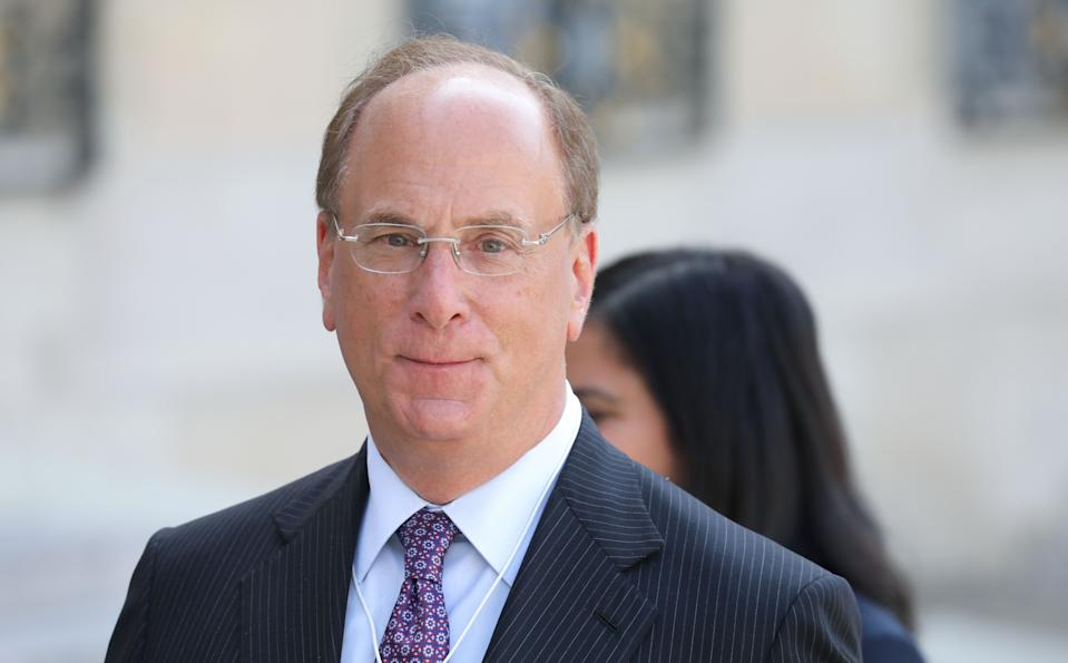Chairman and CEO of BlackRock, Larry Fink (L) leaves a meeting about climate action investments with heads of sovereign wealth funds and French President at the Elysee Palace in Paris on July 10, 2019. (Photo by Ludovic MARIN / AFP)        (Photo credit should read LUDOVIC MARIN/AFP via Getty Images)