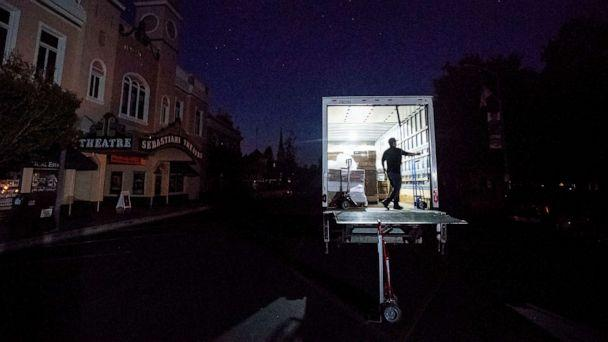 PHOTO: Armando Espinoza delivers paper products to a cafe in downtown Sonoma, Calif., where power is turned off, Oct. 9, 2019. (Noah Berger/AP)