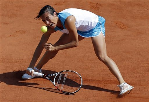Italy's Francesca Schiavone returns the ball to Japan's Kimiko Date-Krumm during their first round match in the French Open tennis tournament at the Roland Garros stadium in Paris, Tuesday, May 29, 2012. (AP Photo/Christophe Ena)