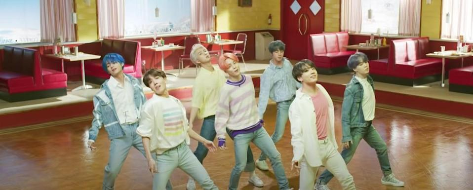 BTS wear pastel clothes and dance in a retro diner in the Boy With Luv music video
