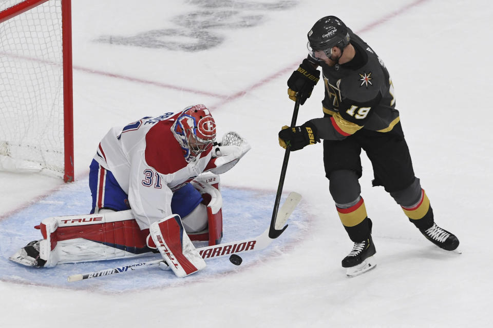Vegas Golden Knights right wing Reilly Smith (19) shoots against Montreal Canadiens goaltender Carey Price (31) during the third period in Game 5 of an NHL hockey Stanley Cup semifinal playoff series Tuesday, June 22, 2021, in Las Vegas. (AP Photo/David Becker)