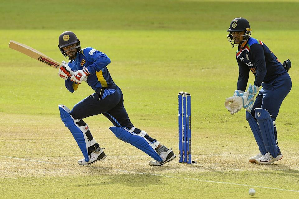 Sri Lanka's Dhananjaya de Silva (L) plays a shot during the second one-day international (ODI) cricket match between Sri Lanka and India at the R.Premadasa Stadium in Colombo on July 20, 2021. (Photo by ISHARA S. KODIKARA / AFP) (Photo by ISHARA S. KODIKARA/AFP via Getty Images)