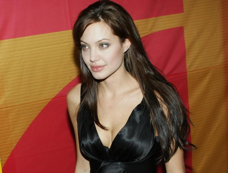 "FILE- In this Aug. 13, 2003 file photo, actress Angelina Jolie arrives at the Mathaeser cinema in Munich, Southern Germany, to attend the German premiere of her latest movie ""Lara Croft Tomb Raider: The Cradle of Life."" Less than two weeks after Jolie had a double mastectomy to avoid breast cancer, her aunt has died from the disease. Jolie's aunt Debbie Martin died at age 61 Sunday in a San Diego-area hospital, her husband Ron Martin tells The Associated Press. Debbie Martin was the younger sister of Jolie's mother Marcheline Bertrand, whose own death from cancer in 2007 inspired the surgery that Jolie described in a May 14 New York Times op-ed. (AP Photo/Uwe Lein, File)"