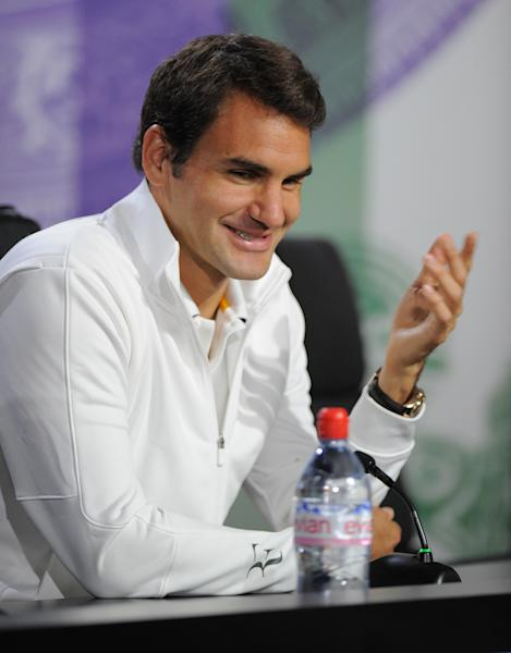 In this photo taken on Sunday, June 23, 2013 and made available by The All England Lawn Tennis & Croquet Club Wimbledon, defending men's champion Roger Federer of Switzerland, gestures during a press conference at Wimbledon. The Championships start Monday, with defending men's champion Roger Federer of Switzerland attempting to win the title for the eighth time. (AP Photo/Jon Buckle/AELTC)