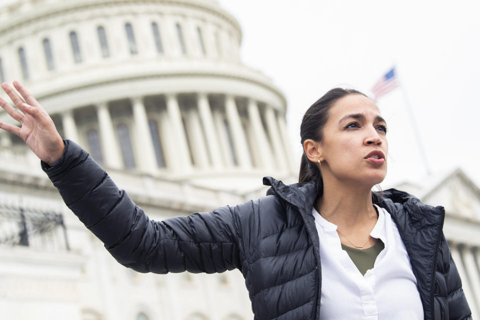 UNITED STATES - AUGUST 03: Rep. Alexandria Ocasio-Cortez, D-N.Y., is seen on the House steps of the Capitol during a vigil lead by Rep. Cori Bush, D-Mo., to call on President Biden and Congress to renew the expiring eviction moratorium on August 03, 2021. (Photo By Tom Williams/CQ-Roll Call, Inc via Getty Images)