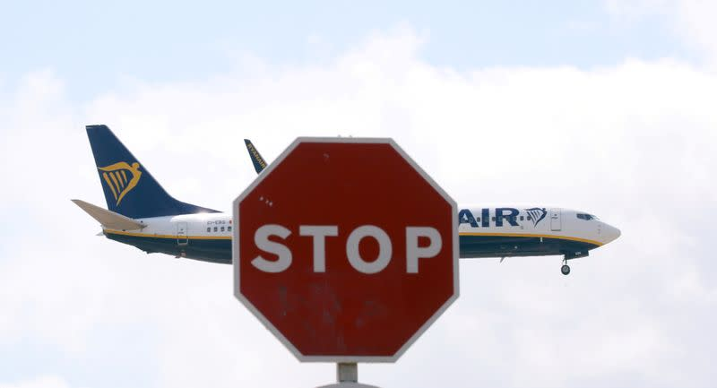 FILE PHOTO: A Ryanair Boeing 737 airplane passes a Stop sign as it lands at Barcelona-El Prat airport