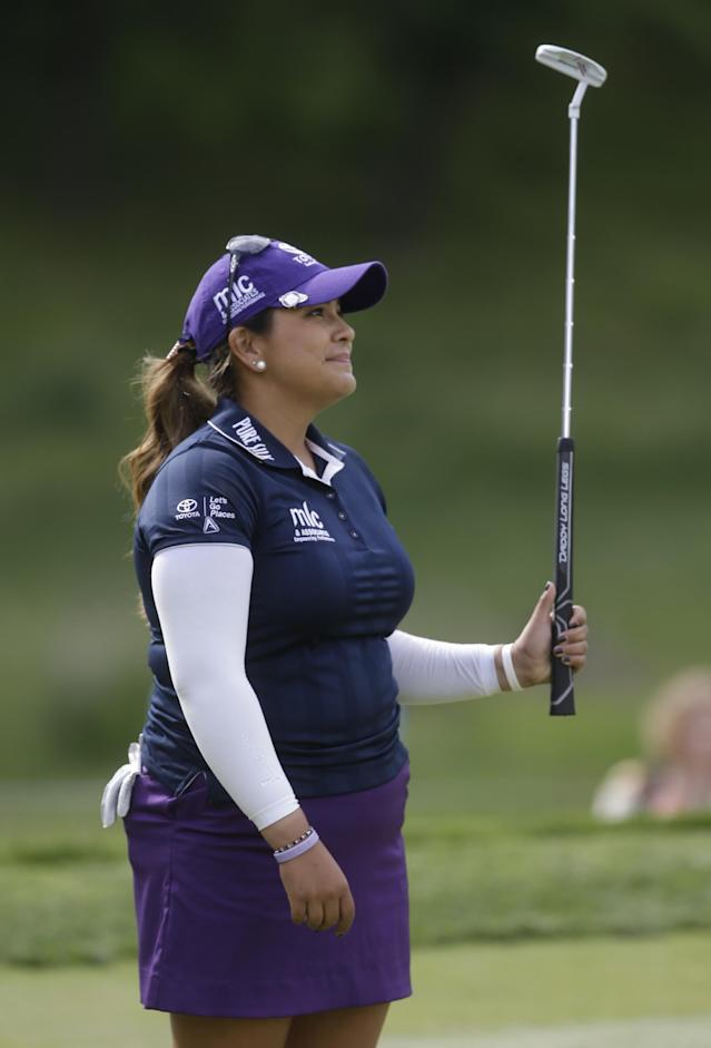 Lizette Salas reacts to a missed birdie on the ninth hole during the final round of the Kingsmill Championship golf tournament at the Kingsmill resort in Williamsburg, Va., Sunday, May 18, 2014. Salas birdied the par-3 hole. (AP Photo/Steve Helber)