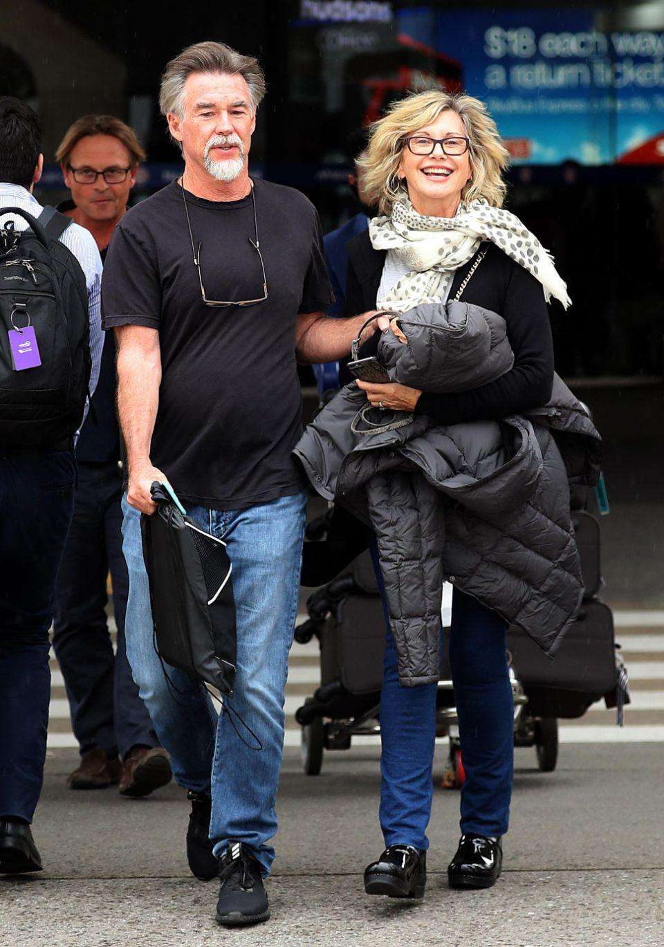 Olivia beamed a big smile as she arrived hand-in-hand with her husband John Easterling in Melbourne. Source: Diimex