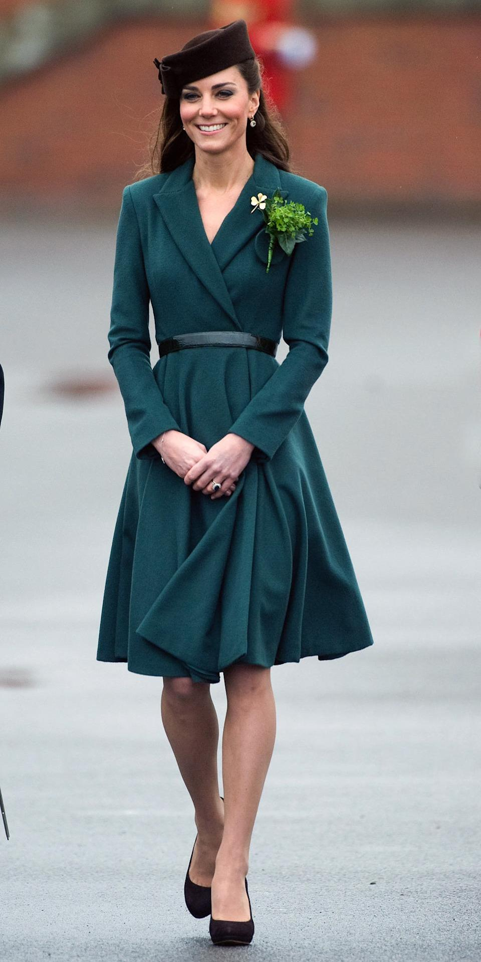 <p>Kate chose a deep green Emilia Wickstead piece and brown Lock & Co hat for St Patrick's Day. She finished with brown pumps by Emmy London. </p><p><i>[Photo: PA]</i></p>