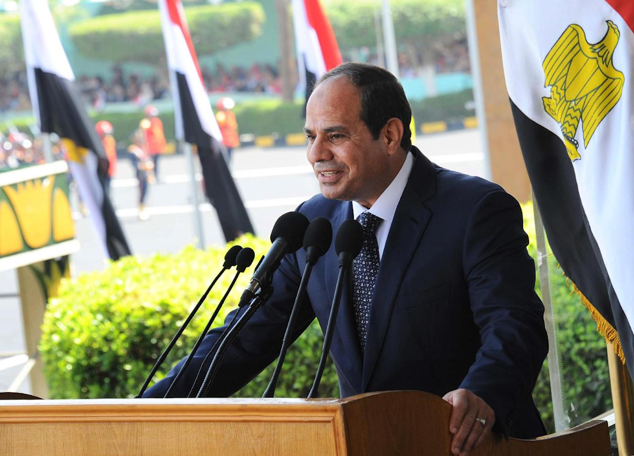 This image released by Egypt's official Middle East News Agency (MENA) shows President Abdel-Fattah el-Sissi speaking at a military graduation in Cairo, Tuesday, June 24, 2014. President el-Sissi said Tuesday he will not interfere in court rulings, rebuffing calls from the United States and other Western governments that he pardon or commute the sentences of three Al-Jazeera journalists handed heavy prison terms a day earlier.(AP Photo/MENA)