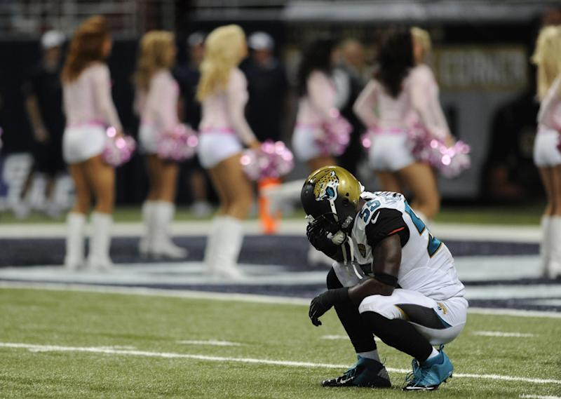 Jacksonville Jaguars linebacker Geno Hayes pauses during the two-minute warning in the fourth quarter of an NFL football game against the St. Louis Rams Sunday, Oct. 6, 2013, in St. Louis. The Rams won 34-20. (AP Photo/L.G. Patterson)