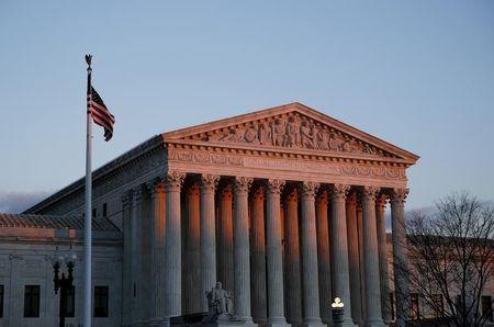 The United States Supreme Court is seen at sunset in Washington December 10, 2014.  REUTERS/Gary Cameron